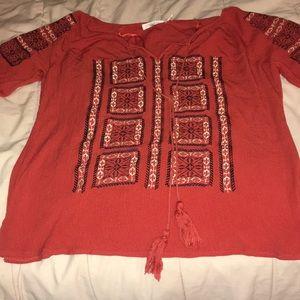 Orange flowy blouse